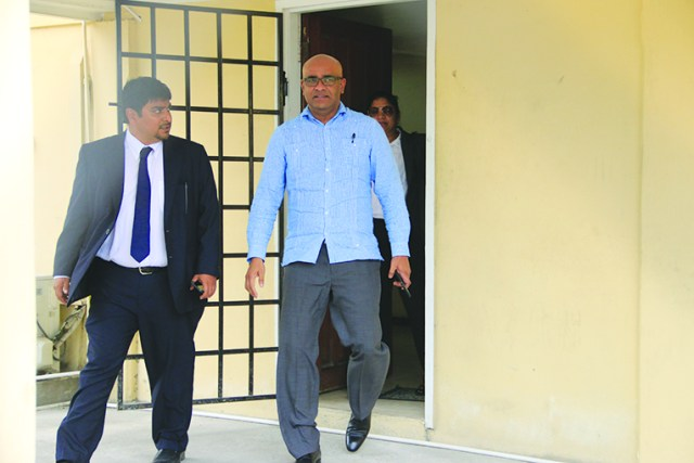 Former President and now Opposition Leader, Bharrat Jagdeo (right) leaving CID headquarters last Tuesday in the company of Attorney Sanjeev Datadin
