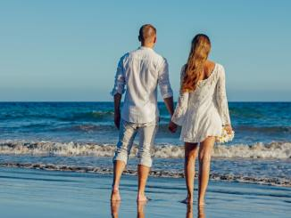 couple on beach romantic setting