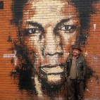 Bristol musician Adrian Thaws - or Tricky... on a wall for UPFEST urban art festival.