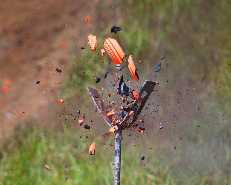 shattering clay target, shattering target, clay target being broken, Fear and Loading, Fear & Loading, Guy Sagi, Guy J. Sagi