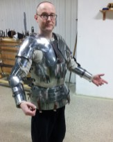 the extra plates at both shoulders, and the left elbow removed.