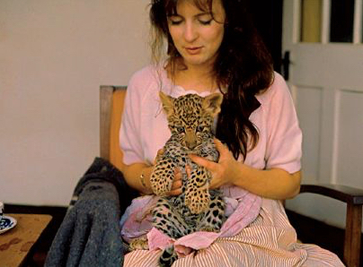 My Mum holding a baby cheetah for hand-feeding, Kenya in the '60s.
