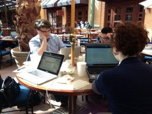 Editors Joe Hogan, Travis Wheeler and Nikki Martin hard at work.