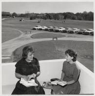 Students sitting on a balcony of Lake Michigan Hall