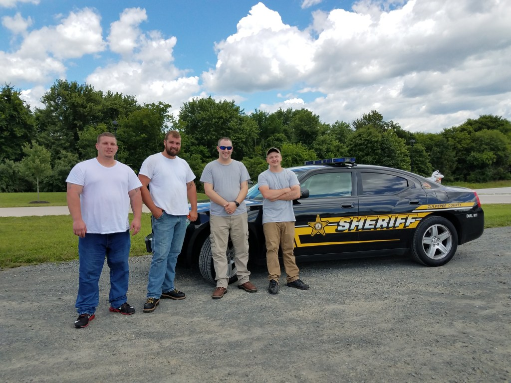 L to R: Kenny Settle, Brandon Fincham, Sgt Jay Hoffman and Freddie Klecar, Culpeper Sheriff's Office inmate worker program, complete moving furniture donated by Yates Properties.  Carver Alumni and Ag Research charities benefit by using the furniture at The Carver Center.
