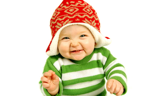 smiling baby with red hat