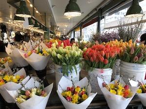 tulips in buckets in a public market
