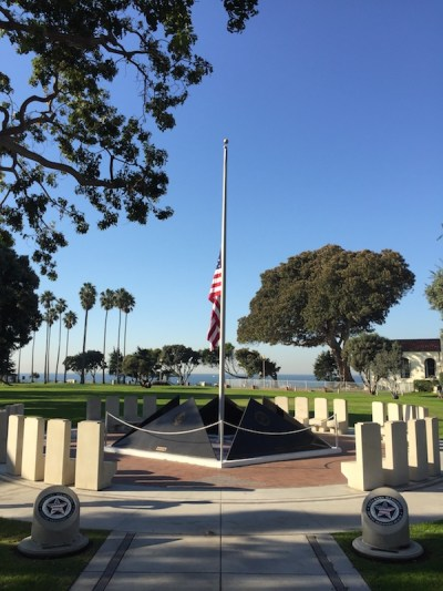 Redondo Beach veterans memorial with flag at half mast