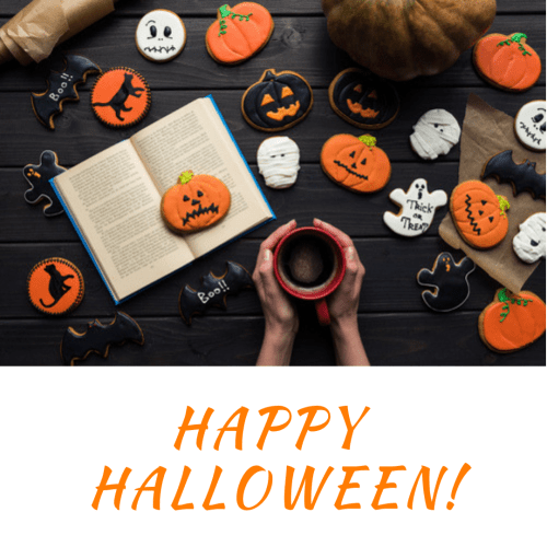 "table filled with Halloween cookies, open book, woman's hands holding a mug, with ""Happy Halloween!"" written across bottom on a white ribbon"