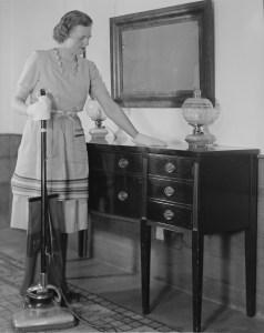 WomanDustingVacuuming
