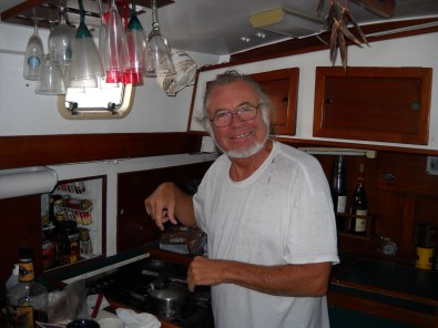 Dad cooking breakfast on the boat