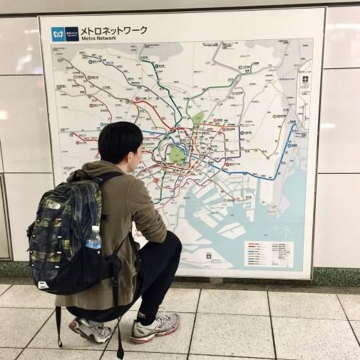 Michael navigates the Tokyo Metro map.