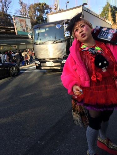 The singer greeting everyone at the entrance to Takeshita Street in Harajuku.