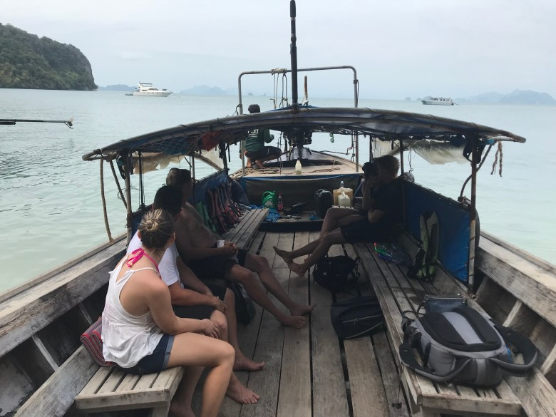 in a small boat in thailand