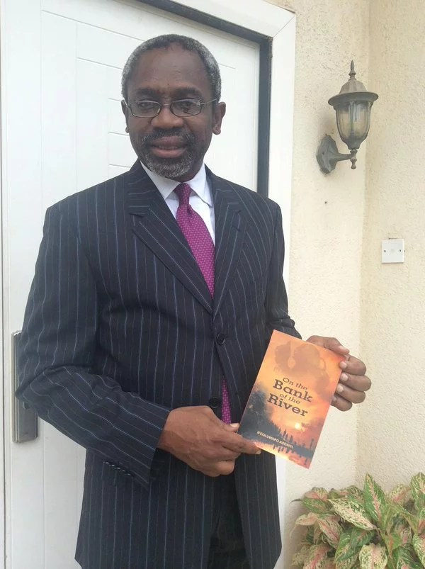 Hon Femi Gbaja Biamila with Ife Adeniyi's Novel Book '' On the Bank of the River ''
