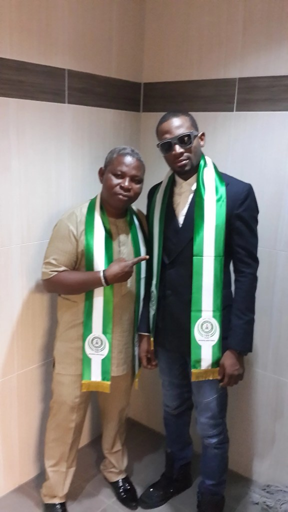Veteran Artistes manager Sunday Are with music star D'banj