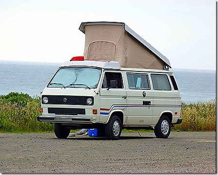 VW camper parked by ocean 3