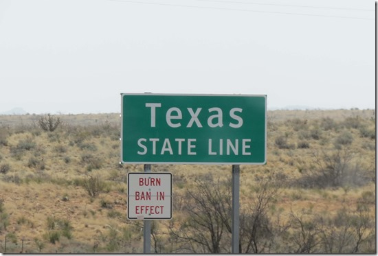 Texas state line sign