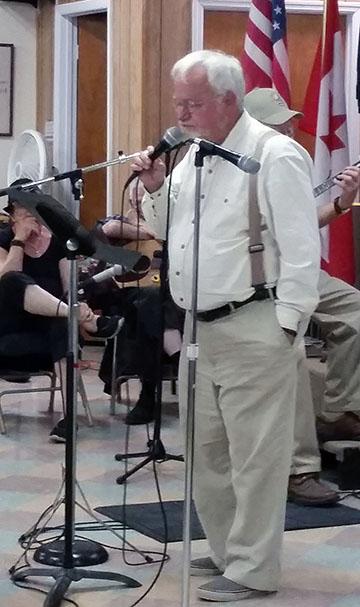 Al singing small