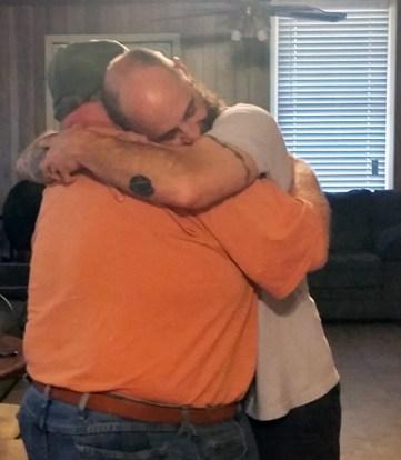 Travis Nick hug small