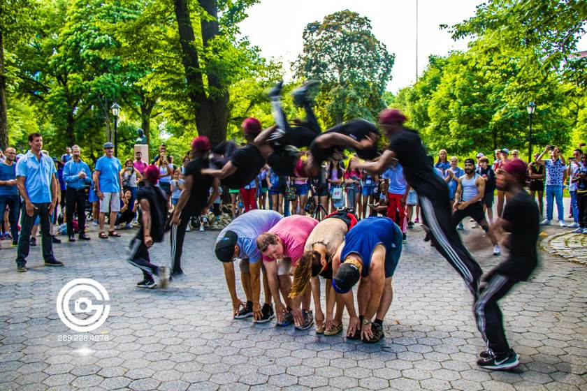 Central Park street performer jumps over crowd