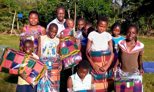 Children in Africa with blankets donated by h2hintl