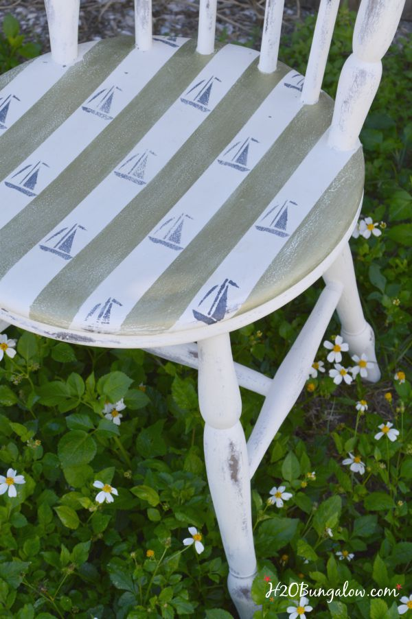 Sailboat stenciled onto chair seat in vintage pattern H2OBungalow
