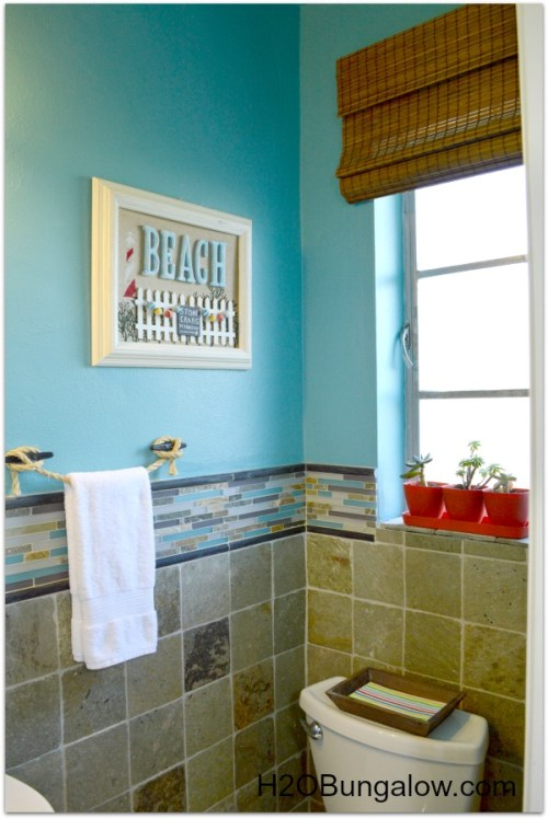 Beachy coastal bathroom makeover that is anything but boring. From the copper tissue holder to the boat cleat towel holder this bath is unique and fun. You won't believe the before! www.H2OBungalow.com