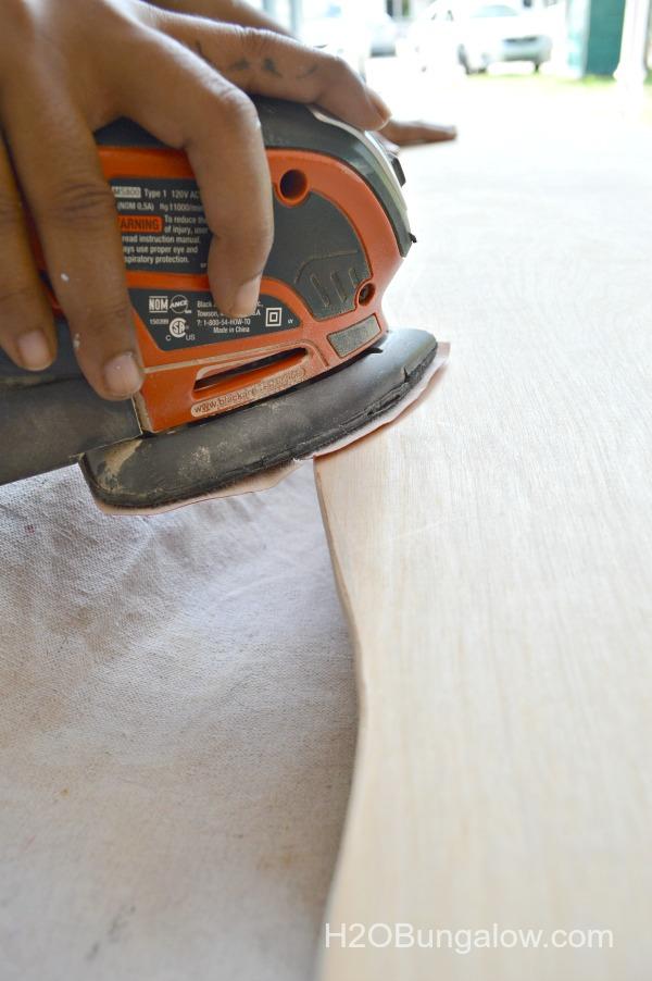 Sand-edges-of-wood-cut-out-shark-H2OBungalow
