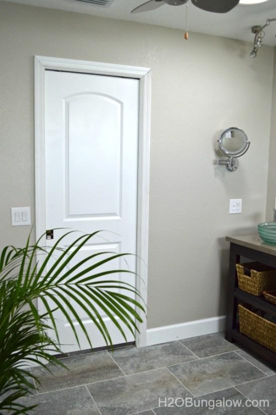 Pocket-door-in-coastal-contemporary-bathroom-makeover-H2OBungalow
