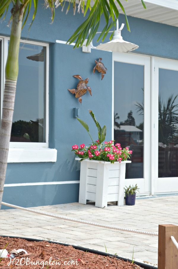 How To Hang Outdoor Wall Decor Without Nails - H20Bungalow on Backyard Wall Decor Ideas id=86573