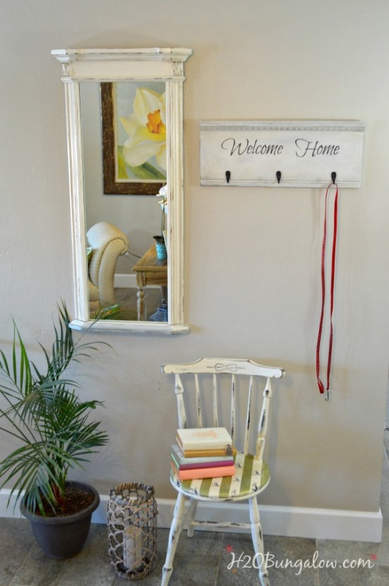 DIY upcycled headboard coat rack with Welcome Home graphics by H2OBungalow
