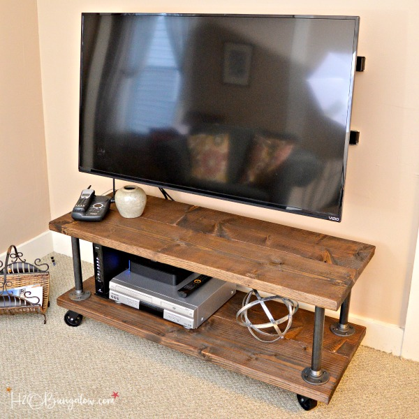 diy-industrial-media-stand-with-wheels