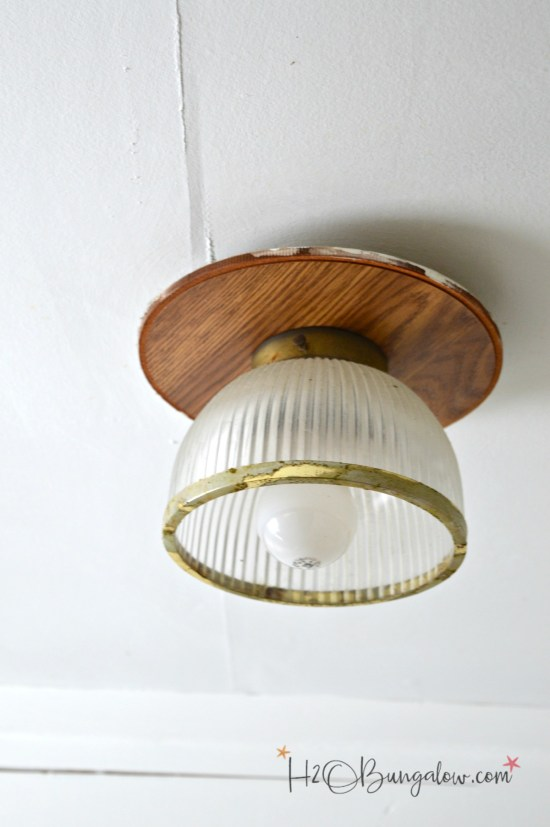 DIY tutorial on how to paint a metal light fixture and change the finish without taking it down from the wall or ceiling.