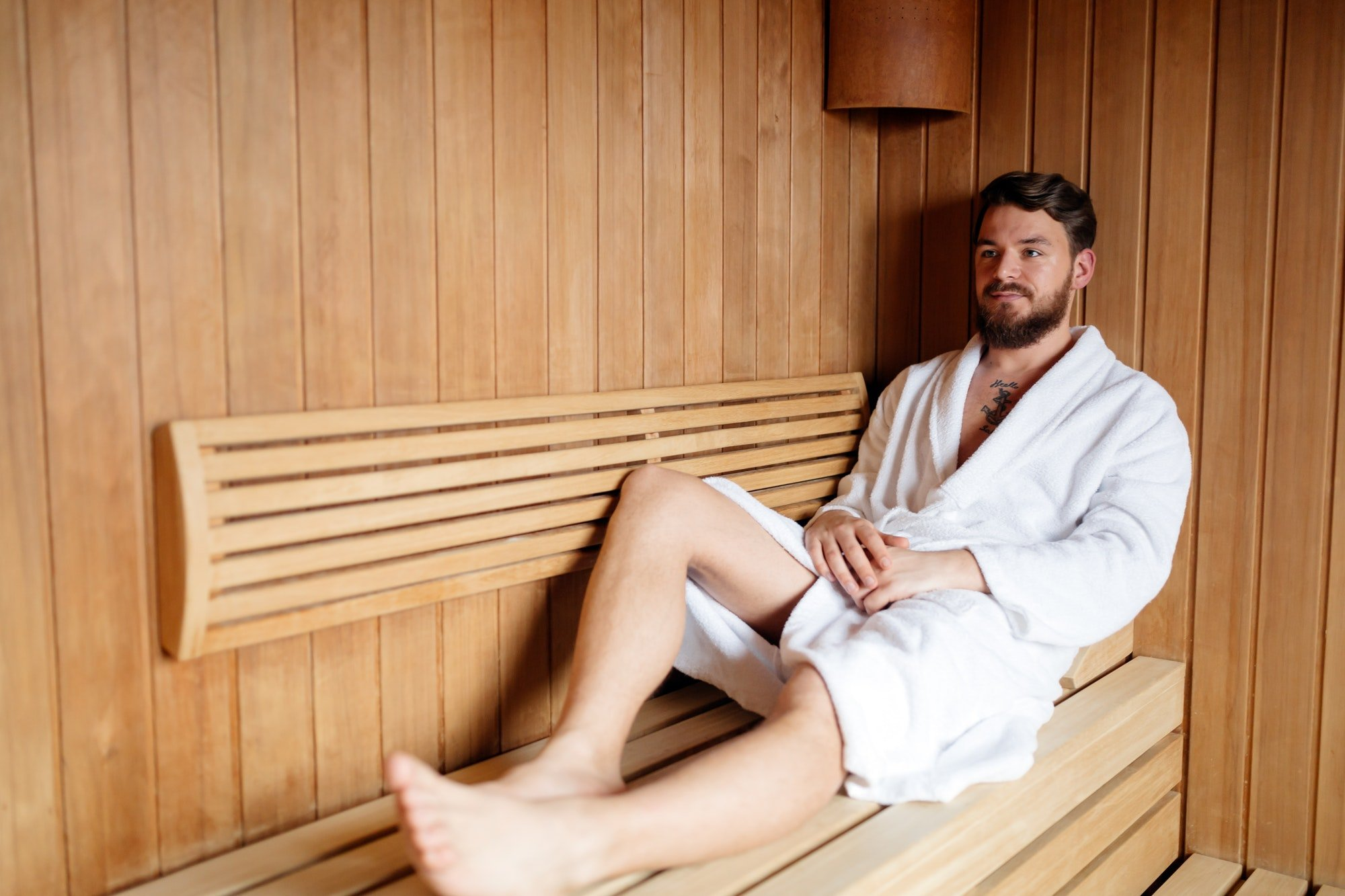 Healthy male in sauna relaxing
