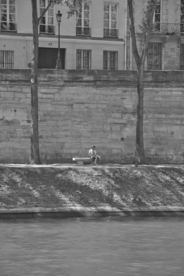 lovers along the river seine, paris