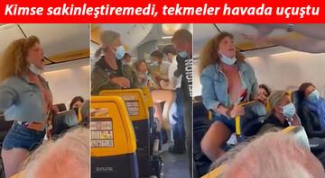 Uçakta inanılmaz anlar... Kadın yolcu maske kavgasında rezalet çıkardı