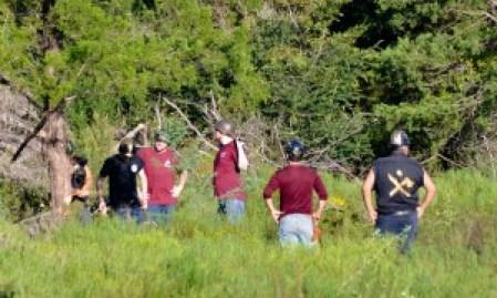 Student Bonfire students clear land at future BCS Habitat subdivision, Hope.