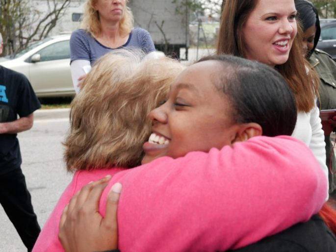 Alicia Zenon is congratulated after the groundbreaking for a new home for her and her daughters Shaniah and Destiny Morris. Zenon hopes to be in her home in April.