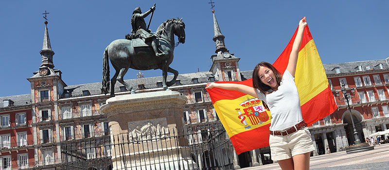 centre of madrid and flag girl