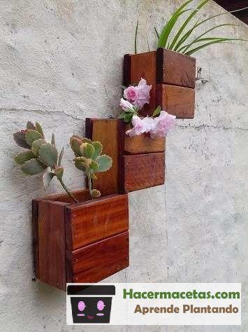 macetas de pared hechas de madera
