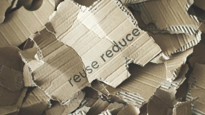 Reuse reduce written on cardboard