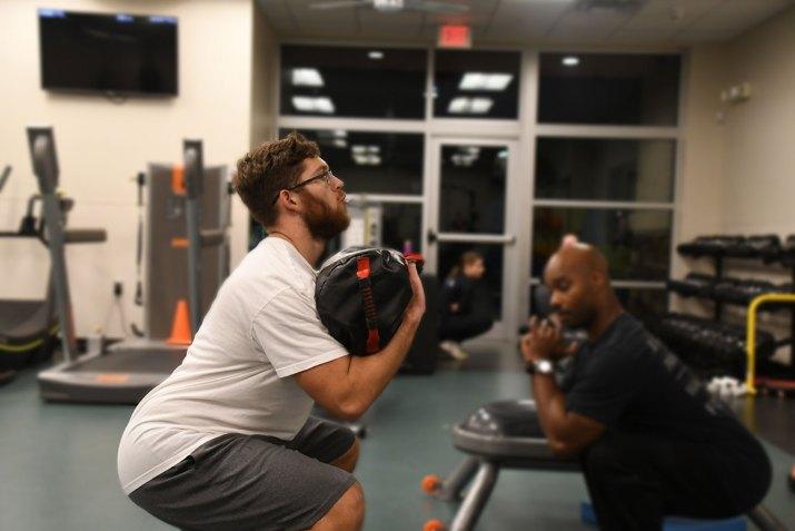 Elliot and Damon doing squats