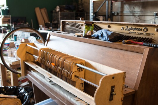 An auto piano being modified to do something....?