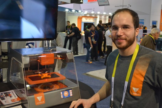 [Michael Bell] poses with the Voxel8