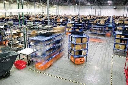 Kiva Warehouse Robots [Photograph by Joel Eden]