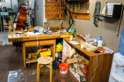 The workspace where the violin repair technician works