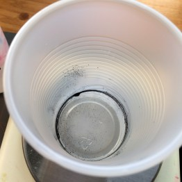 The same amount of dye around the bottom of the cup.