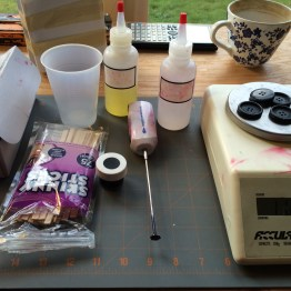 The equipment you'll need for this step. A scale. Mixing sticks or a mixer. Dye. The two parts of the resin. A cup. Coffee.