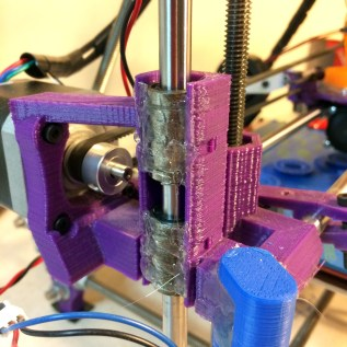 Most repraps have questionable precision linear bearings pressed into 3d printed plastic and held in place by glue or, more commonly, zip ties. Not very precise.